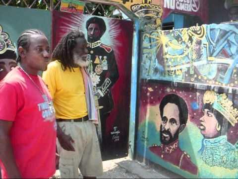 CONGOS -ASHANTI ROY - SHOWING WAYNE LONESOME THE ARTWORK ON CONGOA HQ,