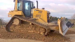 CAT D6 dozer at work pushing gravel for road construction (part 1)