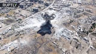 Видео с беспилотника: армия Сирии нанесла удары по позициям боевиков на востоке Дамаска