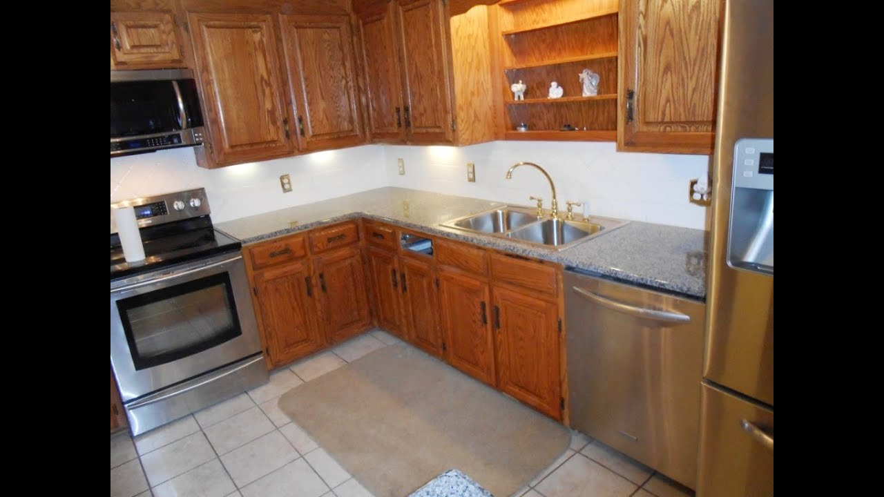 kitchen backslash islands with granite top caledonia -royal cream-desert gold installed ...