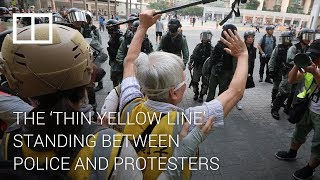 the-thin-yellow-line-standing-between-hong-kong-police-and-protesters