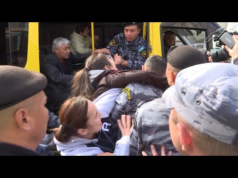 Dramatic Scenes As Kazakh Police Seize Teenager