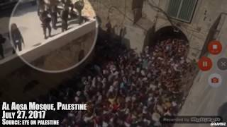 Israeli Soldiers atop Al Aqsa Roof Throwing Explosives at Palestinian Worshippers