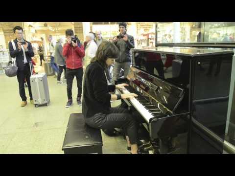 playing Bohemian Rhapsody on Elton John's piano at St. Pancras Station - London