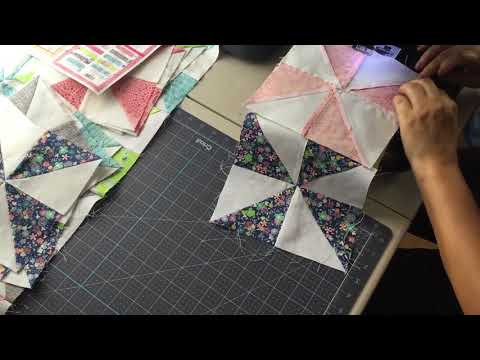 Assembling the Spinning Wheels Quilt Row by Row
