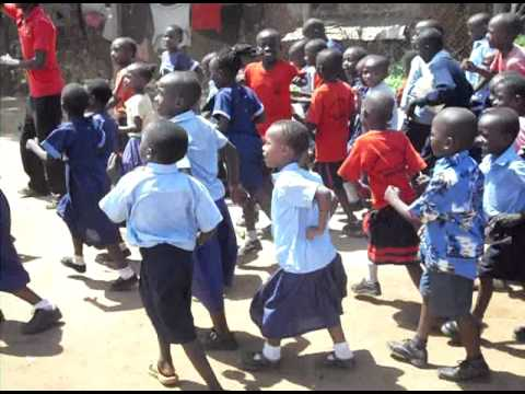 Africa, Kids Cheering On Their School In Football Match