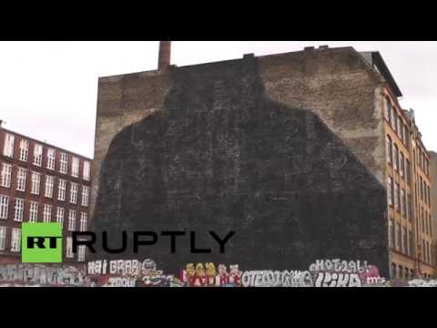 Germany: Iconic Berlin street art covered in black paint