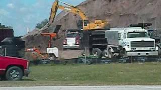 John Deere Excavator loads Mack Dump Truck, Ford Dump Truck & Freightliner Dump Truck on 10-6-09