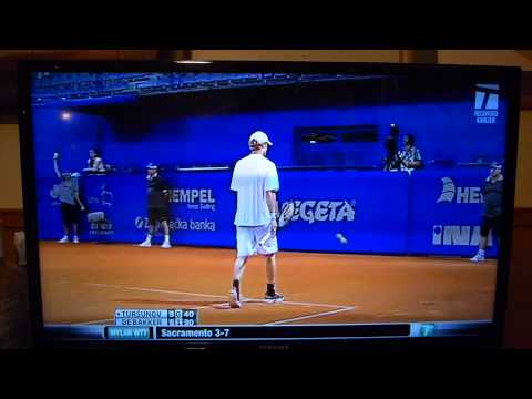 Dmitry Tursunov slams a ball into a lines judge head