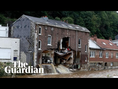Belgian news crew capture moment flooded house partially collapses