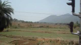 2381 Poorva Express speeds towards Koderma, past Parasnath