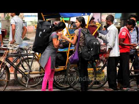 Girls with heavy baggage at the MG road Station