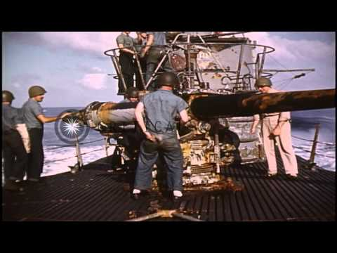 Sailors manning battle stations and fire guns aboard USS Barb submarine in Pacifi...HD Stock Footage