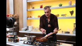 Doru Ungureanu gătește preparatul național brazilian: