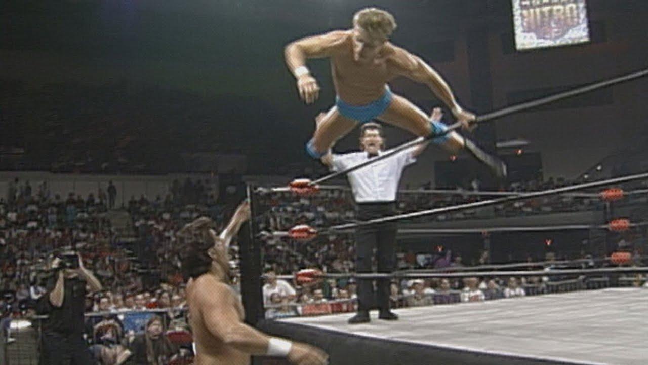 Alex Wright soars over the top ropes to take down Disco Inferno: WCW Monday Nitro, Sept. 25, 1995