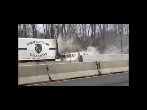 A work van smolders after an accident and fire on I 76 - Herald Video