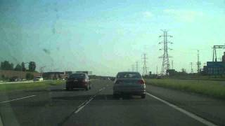 New Jersey Turnpike driving - burning car on the expressway