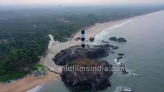 Kaup Lighthouse on huge rock on Arabian Sea shoreline in Karnataka as seen aerially