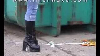 Yoghurt Pot Smashed Under Her Kneehigh Boots