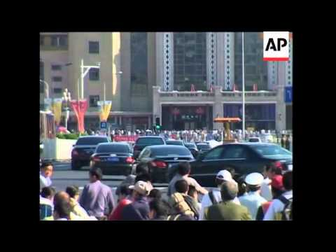 Kim departs Diaoyutai State guest house and heads to train station