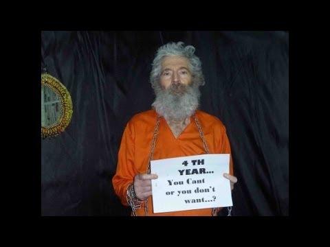Media identify missing man as CIA spy