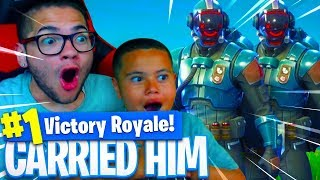 *NEW* BLOCKBUSTER SKIN IS INSANE! CARRYING 9 YEAR OLD BROTHER IN FORTNITE BATTLE ROYALE!
