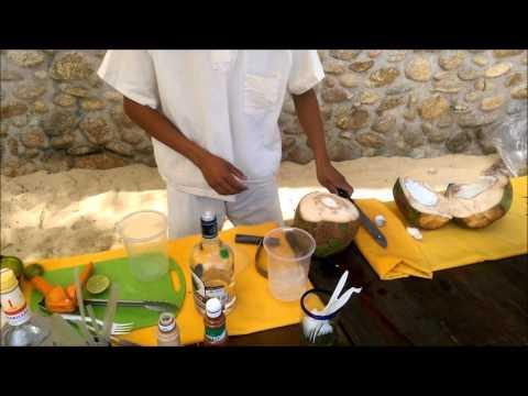 Making Coconut Tequila Cocktail with Big Machete! LAS CALETA BEACH HIDEAWAY - MEXICO