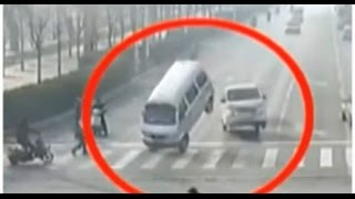 Unbelievable CCTV of 'levitating' car crash goes viral online :: Chinese surveillance video 2015