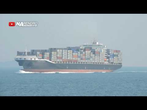 A mighty cargo ship crosses Sunda Strait, Indonesia - Seamax Stamford container ship