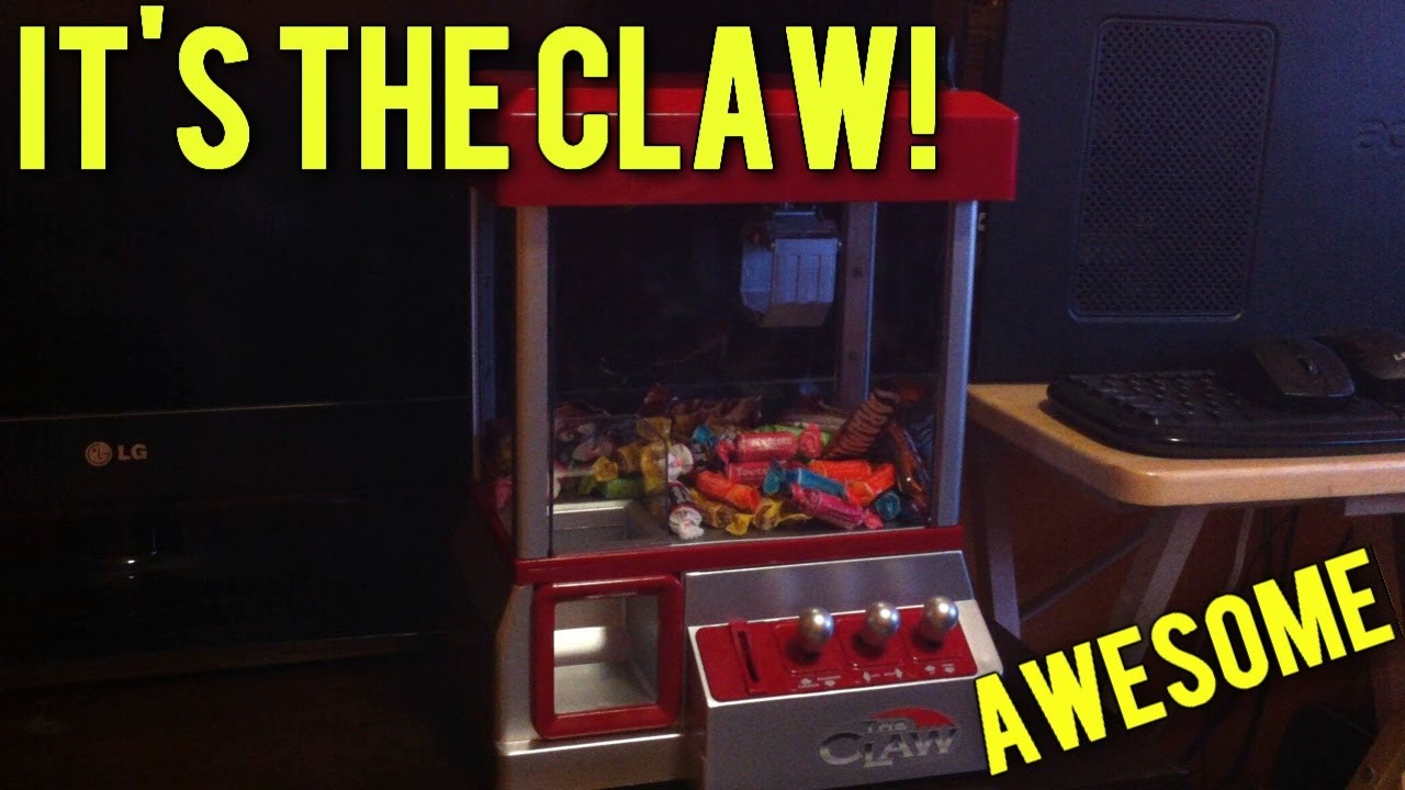 Image result for mini claw machine that takes real money
