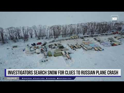 Investigators search snow for clues to Russian plane crash