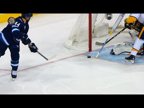 Josh Morrissey looks to sky after Pekka Rinne stick save