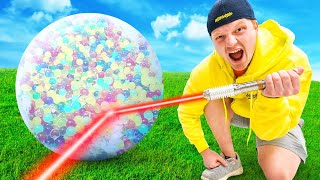1,000,000 Orbeez VS World's Strongest LASER!