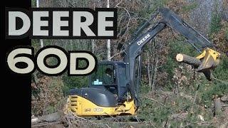 John Deere 60D Mini Excavator Loading Logs into Dump Truck