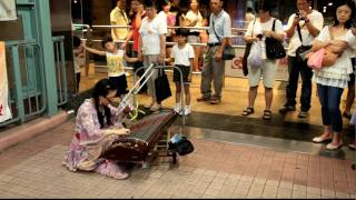 Disabled Street Musician playing 999 Roses