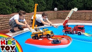 Large cars in the pool: Police car, Fire truck, Concrete mixer, Garbage truck Bruder