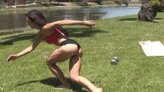 Sexy Female Model Booty and legs ice skate on grass exercise workout.