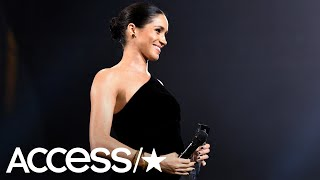 Meghan Markle Cradles Her Baby Bump During Surprise Appearance At 2018 British Fashion Awards