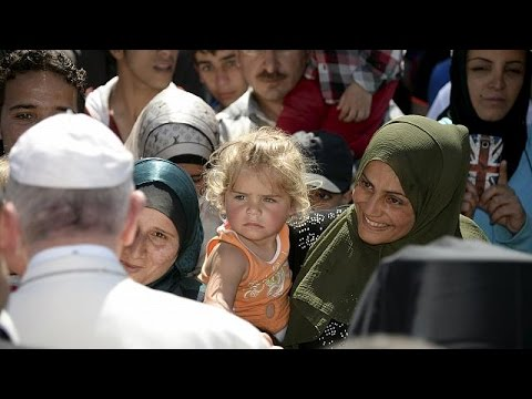 Pope Francis face-to-face with refugees
