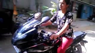 Girl Driving Plusar bike