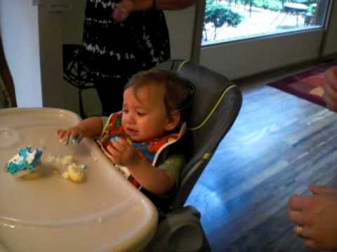 FBH 1st birthday cupcake in high chair.wmv