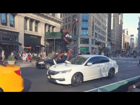 CATCHING FOOTBALLS OVER CARS