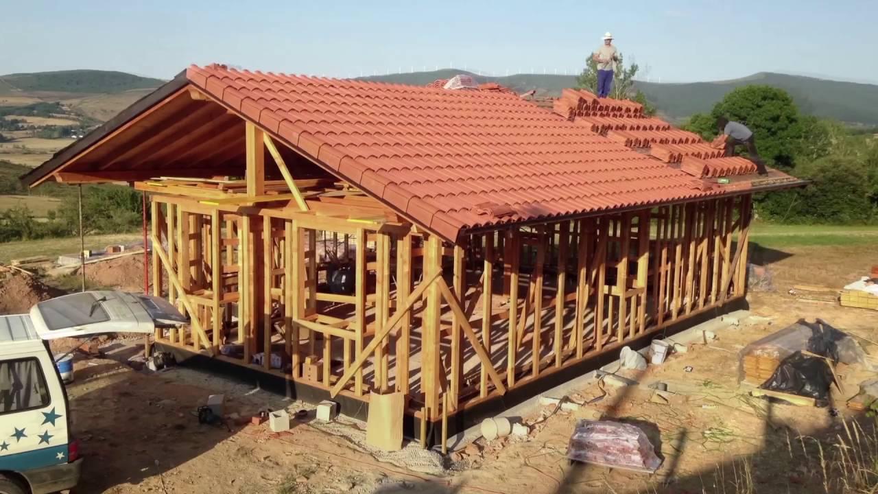 Cubierta de teja en casa de paja youtube for Cubiertas para casas