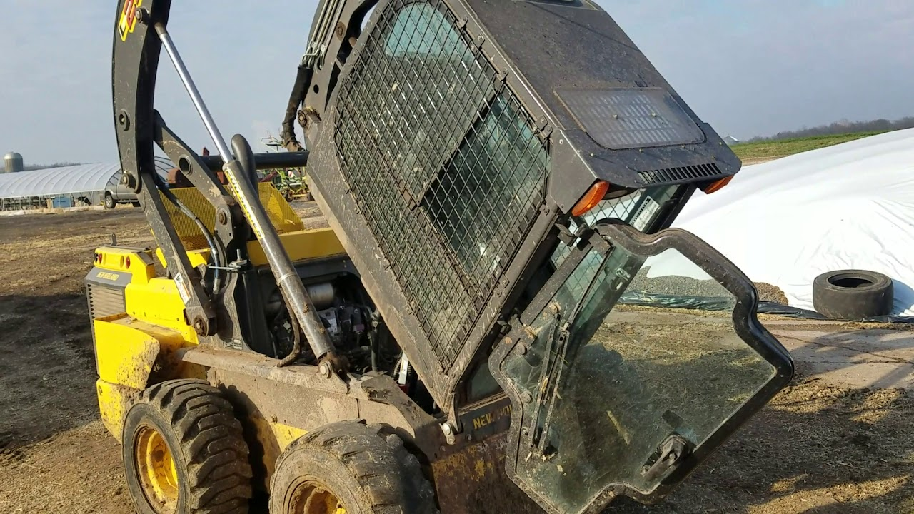 how to lift the cab on the l230 skid loader new holland [ 1280 x 720 Pixel ]