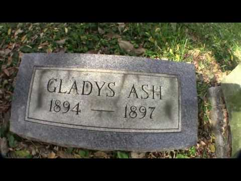 Child's home made Grave Stone in A Giant Old Cemetery, go in a mausoleum full of broken head stones