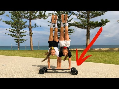 Acro gymnastic stunts on our brothers ELECTRIC SKATEBOARD!
