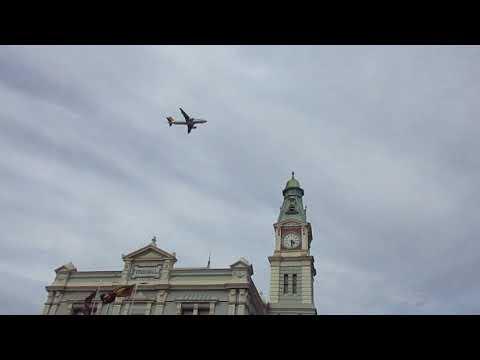 Plane flies over Leichhardt Town Hall in Sydney's Inner West