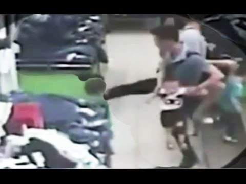Shocking CCTV shows a man kicking a toddler in a shopping mall