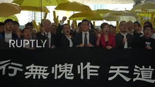 Hong Kong: Hundreds rally ahead of 2014