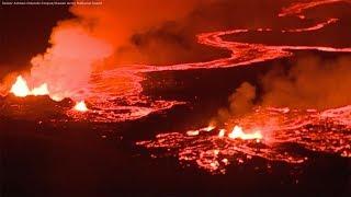 Eerie scene as Kilauea lava burns red in the night